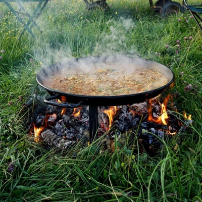 Cooking Paella over an open fire